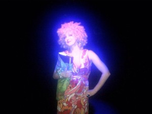 The Singing Psychic on stage Tristan Bates Theatre with her grimoire